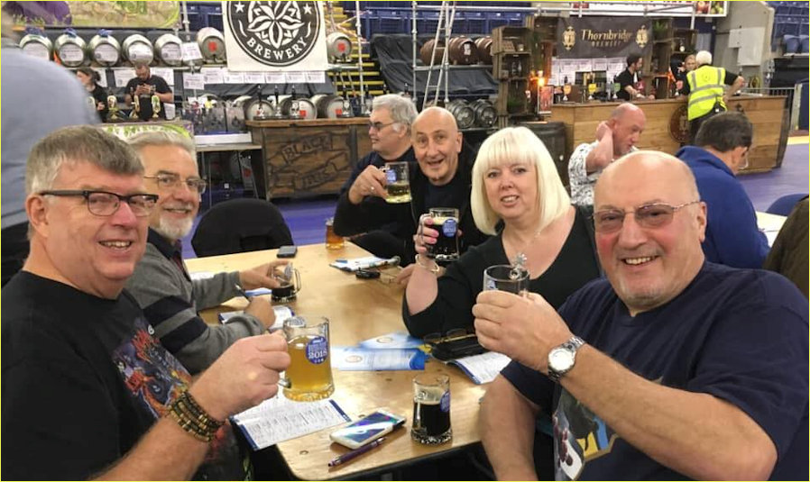 Louise Harrison and Friends raising a glass